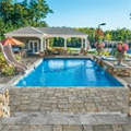 Creative Ways To Incorporate A Waterfall Into Patio And Poolside Hardscapes